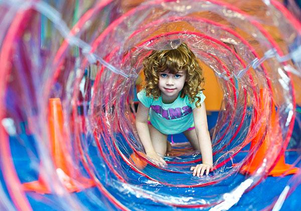 girl hiding in tunnel