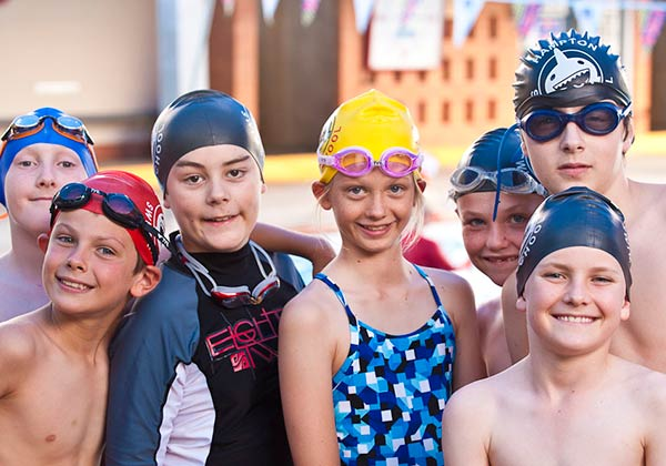 happy swimming kids